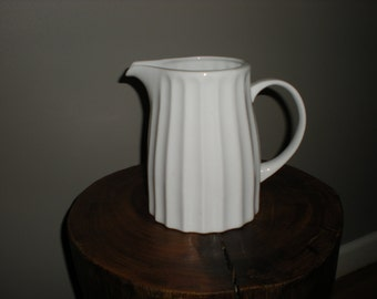 white vintage fluted pitcher