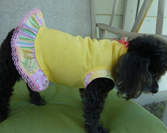 Dog Clothes, Puppy Dress in a Bright Yellow Bodice with short sleeves and a frilly ruffle in a Spring Motif and a Hot Pink Bow.
