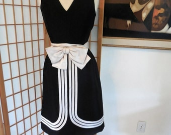Vintage 60s Black Sleeveless Dress in Wool Gaberdine Blend V Neck with Large Ivory Satin Front Bow
