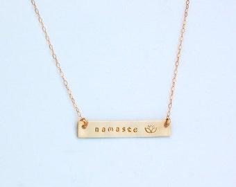 Gold bar necklace namaste and lotus