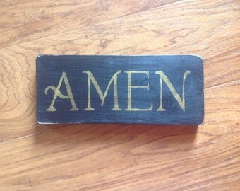 Amen sign or shelf sitter