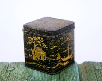 Black and golden Chinese tea tin
