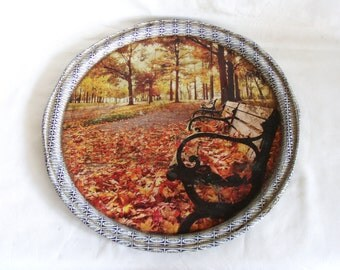 Autumn Leaves, benches at the park. Vintage tin plate. Fall foliage. End of Summer. Urban landscape. Quiet,peaceful solace. Tinplate, round