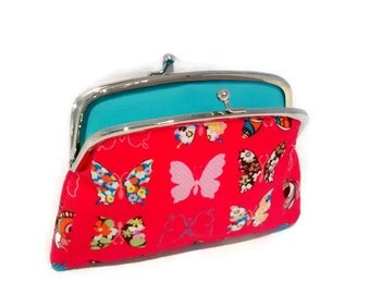 Hot pink butterfly wallet with  2 compartment sections with divider in turquoise.