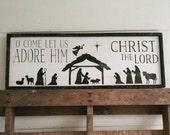 O come let us adore him nativity scene sign
