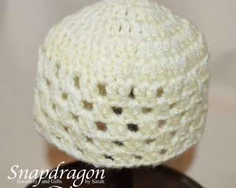 Lace crochet newborn hat in pale lemon yellow