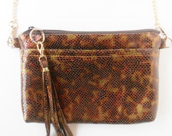 Patent leather, shoulder bag, or crossbody bag, in golden browns, reptile embossed leather.