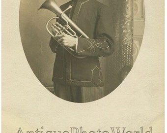 Soldier in uniform with euphonium woodwind instrument antique photo