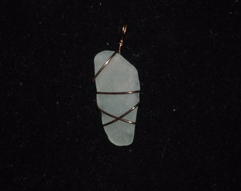 white glass wrapped in copper wire