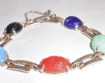 Vintage Scarab bracelet Lucite Fruit Salad Egyptian Revival Carved beetles Gold tone metal with safety chain