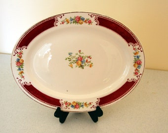 Majestic by Homer Laughlin-large oval serving platter-raspberry wine with scrolls and multicolor floral-burgundy band