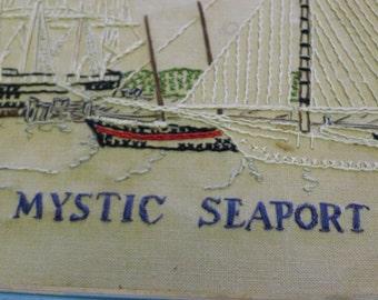 Framed needlework of Mystic Seaport