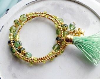 Bracelet, peridot green and gold tassel and flower wire wrap bracelet