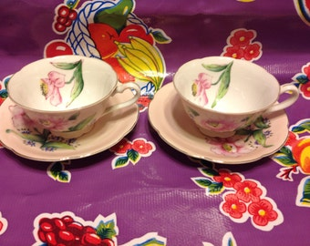 Vintage Ucagco China handpainted pair of teacups and saucers with pink floral designs- Japan