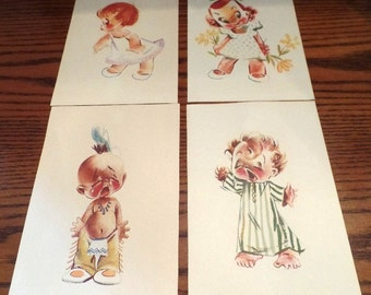 Set of four, adorable art prints of children, circa 1960s.