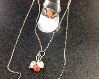 Coral rose ring and pendant set