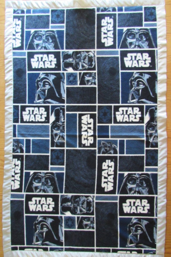 Star Wars fleece blanket with gray satin edge in sizes babby, toddler, oversize toddler, adult throw, and twin