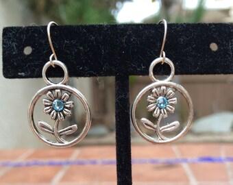 Round silver tone daisy flower earrings with Swarovski crystal