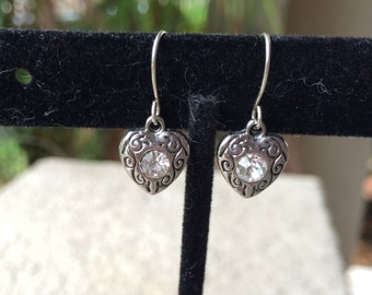 Tiny small silver tone heart earrings with clear rhinestone