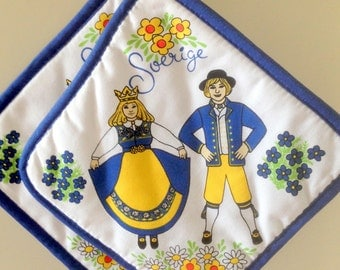 Fine cloth potholders padded with a traditional motif of Scandinavia /Swedish Midsummer and costumes