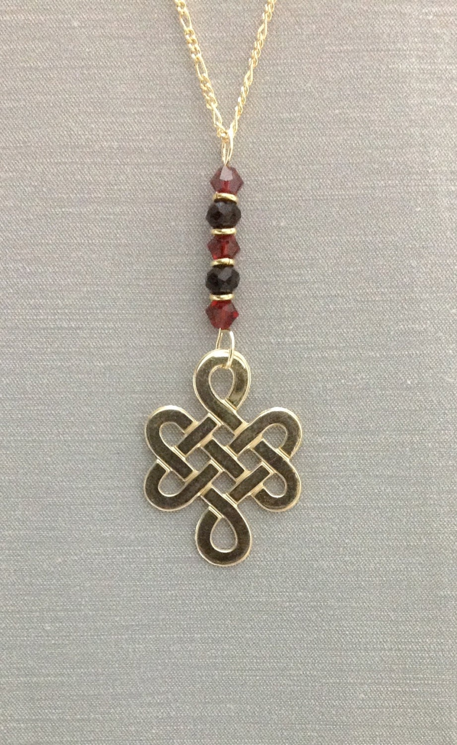 endless knot pendant made of 14k gold filled wire wrapped