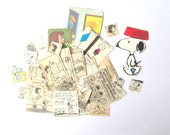Peanuts craft pack: 50 vintage paper pieces featuring Snoopy, Charlie Brown. Embellishments for scrapbooks, journals, card making.