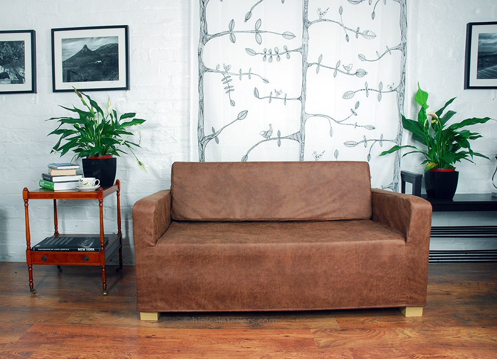 Ikea ullvi sofa bed slip cover in distressed effect leather for Futon covers ikea