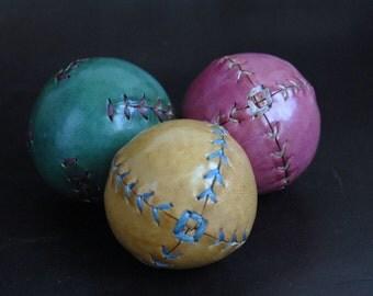Set of  three leather juggling balls
