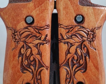 Taurus PT92 with Decock Grips with Raging Tribal Taurus, Bull engraving
