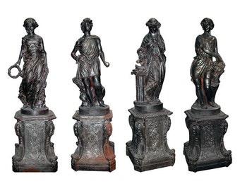 "70.3126 Set of Four Cast Iron Garden Figures - ""The Four Seasons"""
