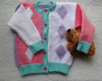 Girls Jacket Cardigan Size 24 inch chest approx  2 to 3 years. Hand knitted in Multi colour DK yarn.
