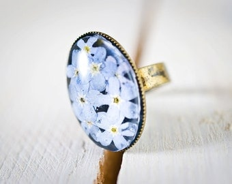 Resin ring with real  forget-me-nots