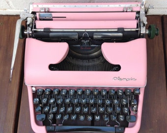 Reduced due to faulty 5/8 key: Pink Typewriter - Olympia SM3