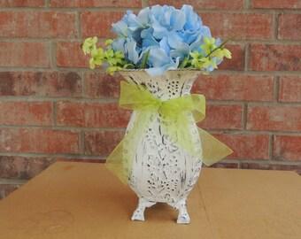 White vase with large blue hydrangea centerpiece