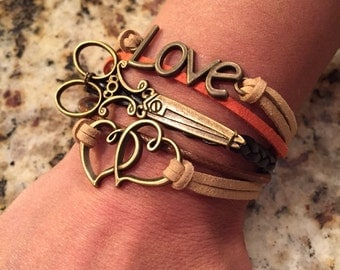 Leather scissor bracelet with antique bronze metal scissor, hearts, and love! Stylish!