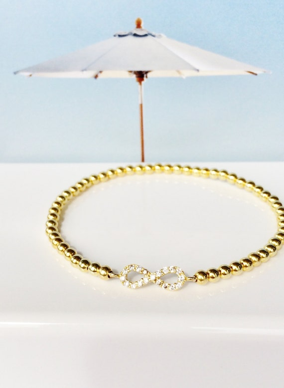 Infinity bracelet in gold plated 925 sterling silver and zirconia, Stretch and safe to get wet