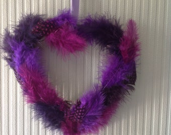Bright and vivid feathered wooden heart.