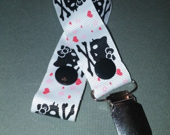 Kitty Skull and Crossbones Pacifier Clip