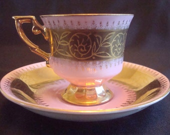 Pretty Iridescent demitasse or tea cup with gold trim ***Price was 19.98   Reduced 14.98