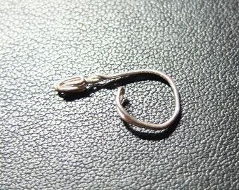 fake piercing ear