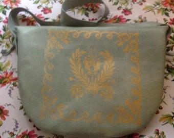 Leather silk screened handbag