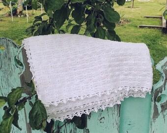 Crochet white cotton baby blanket