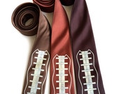 Football necktie. Football lacing print men's tie. Silkscreened sports theme gift. Your choice of browns or custom team colors!