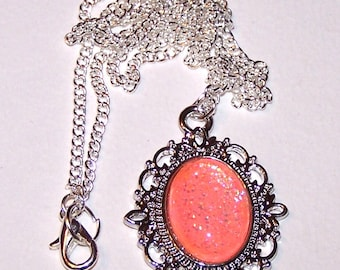 lovely coral glow-in the dark pendant on silver-plated chain