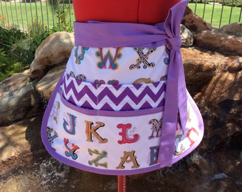 Back to School Alphabet Teacher Utility Apron, Sturdy Half Apron with 6 pockets, Great for Vendors, Sewing, Crafts, Arts, Farmers Market