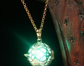 Necklace - Golden locket with glowing Orb