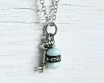 Dainty antique silver charm necklace.  Tiny skeleton key with Amazonite and rhinestone stacked beads.