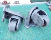 pair of iron swivel casters, heavy duty steel wheels, industrial paperweight, floor jack, sculpture supply, steampunk wheels