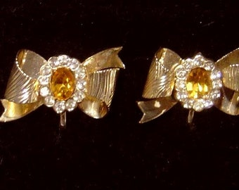 Signed CORO bow Earrings with topaz glass stone and rhinestone accents