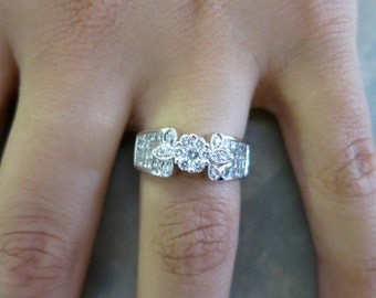 14K white gold engagement flower ring.